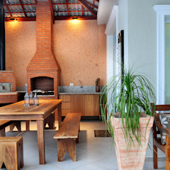 Balcones y terrazas rústicos de studio VIVADESIGN POR FLAVIA PORTELA ARQUITETURA + INTERIORES Rústico