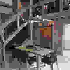 Industrial style dining room by Anton Medvedev Interiors Industrial