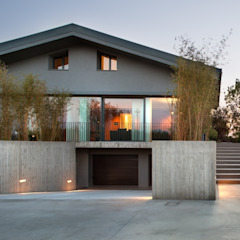 Salon moderne par MIDE architetti Moderne Verre