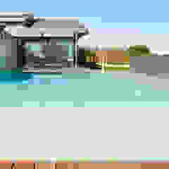 Piscine moderne par MIDE architetti Moderne
