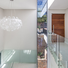 Couloir, entrée, escaliers modernes par MARVIN FARR ARCHITECTS Moderne