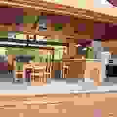 Área de lazer rústica. Varandas, alpendres e terraços rústicos por Lozí - Projeto e Obra Rústico