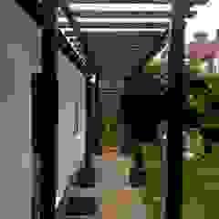 Conversion of an Outbuilding into a Gym in Wandsworth من XTid Associates بحر أبيض متوسط خشب Wood effect
