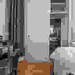 Master Bedroom leading to hidden en-suite behind sliding wardrobe - very chic Millennium Interior Designers