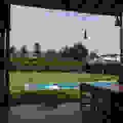 Una CASA DE CAMPO para soñar Balcones y terrazas rústicos de malu goni Rústico