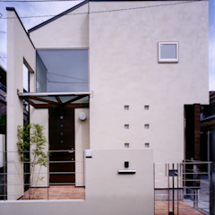 Modern houses by 豊田空間デザイン室 一級建築士事務所 Modern Solid Wood Multicolored