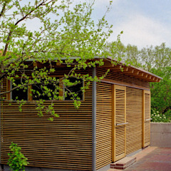 Colonial style garage/shed by Archwerk Morenz Colonial Wood Wood effect