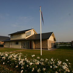 Country style house by buro voor advies en architectuur pieter e. bolhuis Country Stone