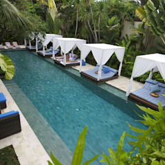 Seminyak Villas Resort Main Pool Tropical style hotels by The Elysian Tropical Limestone