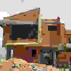 Vista Frontal. Vivienda V12. Obra Gris. Casas de estilo escandinavo de Eisen Arquitecto Escandinavo Concreto