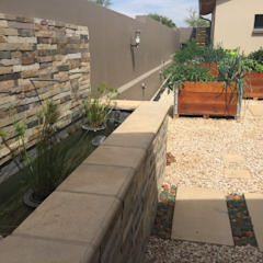 Water feature focal point in kitchen garden Country style garden by Acton Gardens Country