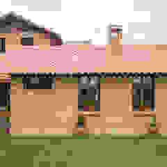 Casas de estilo rural de Ensamble de Arquitectura Integral Rural Ladrillos