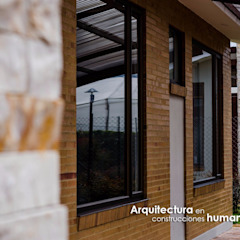 Modern home by DG ARQUITECTURA COLOMBIA Modern Bricks