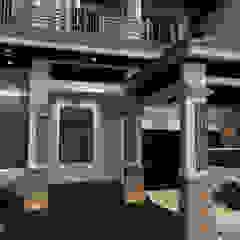 Rumah Bergaya Etnik yang Dikemas Lebih Modern Oleh AIRE INTERIOR Modern Batu