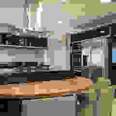 Apartamento ML por Maluf & Ferraz interiores Moderno Granito