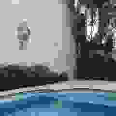 Residência Paineiras por Ambiento Arquitetura Tropical Pedra