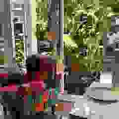 Residencia Coelho, Cozinha, Quarto, Academia. Egzotyczna siłownia od STUDIO AGUIAR E DINIS Egzotyczny
