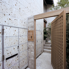 Asian style house by 株式会社 ギルド・デザイン一級建築士事務所 Asian Stone