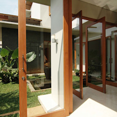 Tropical style windows & doors by daksaja architects and planners Tropical