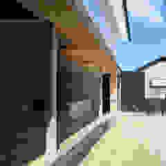 من 伊藤憲吾建築設計事務所 أسيوي خشب Wood effect