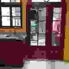 de homify Colonial Madera maciza Multicolor