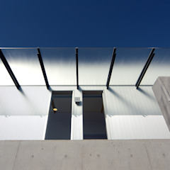 Hospitais eclécticos por アトリエ間居 Eclético Betão