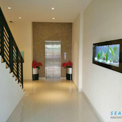 Welcome your guests with the stunning wall mounted aquarium by Seazone Innovative Sdn Bhd Modern