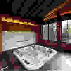 Casa de vacaciones y Spa en estilo japonés de Studio B&L Asiático Madera maciza Multicolor