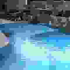 Jardim em Florianópolis por Raul Hilgert Arquitetura de Exteriores Tropical Granito