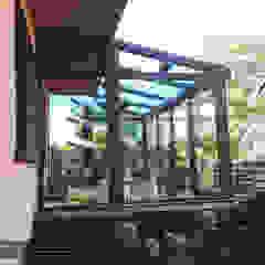 Ogród zimowy pod balkonem Nowoczesny ogród zimowy od P.W. Przybylski Nowoczesny Aluminium/Cynk