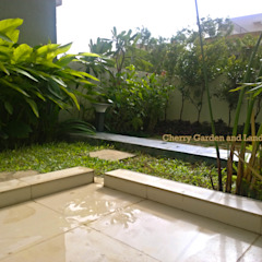 Backyard Garden Project - Harlur Tropical style garden by Cherry Garden and Landscapers Tropical