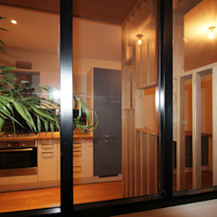 Agence ADI-HOME Modern kitchen Metal Black