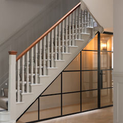 Under stair storage by Shape London 모던