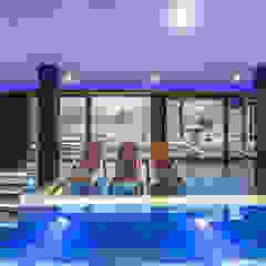 Realizacja salonu w domu jednorodzinnym w Rudzie Śląskiej Minimalistyczny basen od Archi group Adam Kuropatwa Minimalistyczny