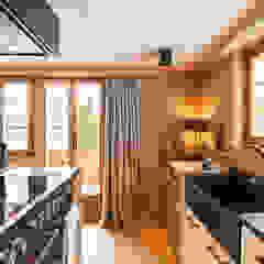 من RH-Design Innenausbau, Möbel und Küchenbau Aarau ريفي خشب معالج Transparent
