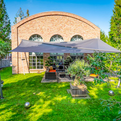 Pina GmbH - Sonnensegel Design Jardines de estilo moderno Gris