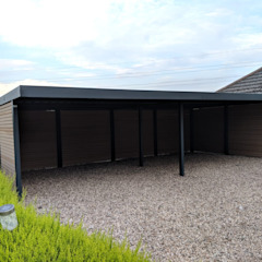 Multi bay carport for a Motor Racing Industry Professional de wearemodern limited Moderno Hierro/Acero