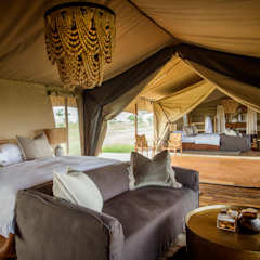 Siringit Serengeti, Tanzania Rustic style bedroom by Meg Vaun Interiors Rustic