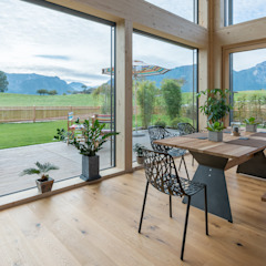 Modern dining room by Bau-Fritz GmbH & Co. KG Modern