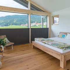 Modern style bedroom by Bau-Fritz GmbH & Co. KG Modern