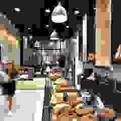 Agencement et aménagement d'une boulangerie à Lyon Espaces commerciaux modernes par Tiffany FAYOLLE Moderne