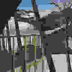 Industrialny ogród zimowy od Logan Leyton Arquitectos Industrialny Drewno O efekcie drewna