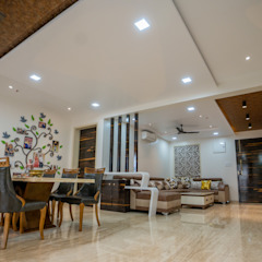 Luxurious Dining Area Designed by Nabh Design & Associates Nabh Design & Associates Modern dining room Solid Wood Beige