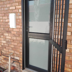 AFTER CONVERSION TO CHARCOAL ALUMINIUM STABLE DOOR WITH WHITE TRANSLUTION GLASS by ALUWOOD WINDOWS AND DOORS