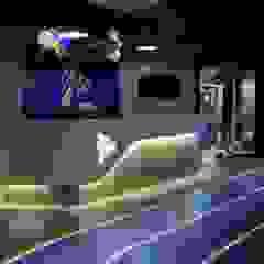 Sede Wplay - Medellín Pasillos, vestíbulos y escaleras de estilo industrial de Proyecto Decc S.A.S. Industrial Granito