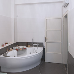 Appartamento Liberty in centro storico Studio di Architettura IATTONI BagnoBagno di servizio