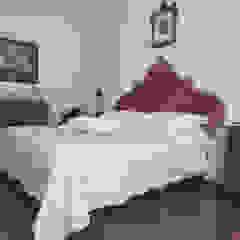 Appartamento Liberty in centro storico Studio di Architettura IATTONI Camera da lettoLetti e testate