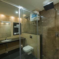 Modern toilet interiors with glass cubicles Offcentered Architects Modern Bathroom