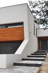 Casas de estilo moderno de STRUKTURA Łukasz Lewandowski