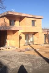 maison bioclimatique: Maisons de style de style Moderne par AeA - Architecture Eric Agro